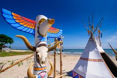 Native american indian tepee and totem pole on the beach blue sk. Y day.Thailand Stock Image