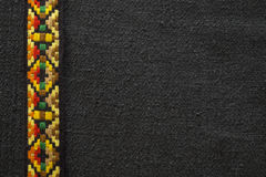 Native American Indian Trim on a Black Background. Native American Indian style fabric on a black background.  It has a tribal or bohemian style to it Royalty Free Stock Photography