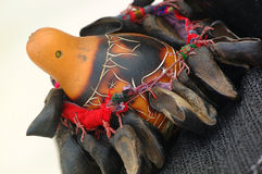 Native American instrument. A colorful gourd with decorative items attached used by Native American Indians as a musical instrument Royalty Free Stock Photography