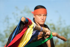 Native American man with colorful flags Royalty Free Stock Photo