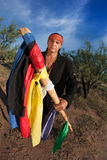 Native American man with colorful flags Royalty Free Stock Photography