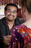 Native American man with female friend in restaura. Handsome Native American man with female friend in a restaurant Stock Photos