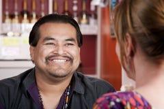 Native American man with female friend in restaura Stock Photo