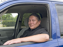 Native American man in his car. Native American man sitting in his blue car Royalty Free Stock Photography