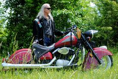 Native American man with Indian Motorcycle. Native American man enjoying the country on his Indian motorcycle Royalty Free Stock Photos