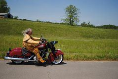 Native American man on Motorcycle. Native American man riding through the country on his Indian motorcycle Stock Photography