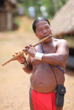Native american man playing a flute Royalty Free Stock Photo