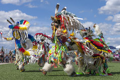 Native American men dancing at powwow. Stock Image