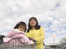 Native American mother & daughter ready to shop Stock Photo