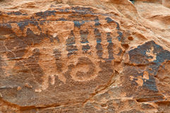 Native American petroglyph on canyon wall. Valley of fire SP Stock Image