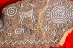 Native American Petroglyph Symbols. Ancient Indian symbols etched in sandstone rock at Canyon de Chelly in Arizona Royalty Free Stock Image