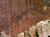 Native American petroglyphs. 3,000 year old Native American petroglyphs carved in red sandstone in the southwestern USA deser - Capitol Reef - Utah, USA Royalty Free Stock Images
