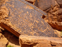 Native American Petroglyphs. Ancient drawings on snadstone rock at Valley of Fire State Park, Nevada Royalty Free Stock Photo