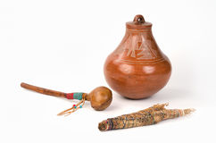 Native American Pueblo Pottery with Smudge Stick and Shaker. Native American Pueblo Pottery with Smudge Stick and Shaker on a white background Royalty Free Stock Image