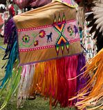 Native American Ribbon and Applique Shawl Worn by Woman at Pow Wow. Native American woman wearing appliqued shawl with flower and horse motif and colorful ribbon royalty free stock images