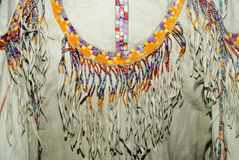 Native American Shirt. Closeup of a Native American shirt made of animal hide and decorated with beads Royalty Free Stock Photography
