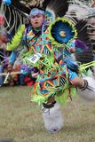 Native American teen dances in full costume. Royalty Free Stock Photography