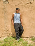 Native American teenage boy. Portrait of a handsome 15 year old Native American boy by an adobe wall Stock Photos