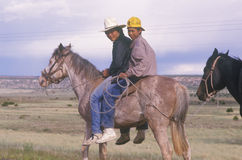 Native American teenagers on horseback, NM stock images