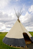Native american teepee. In prairie with sky royalty free stock photos