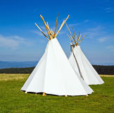 Native American teepee. In green mountains stock photos