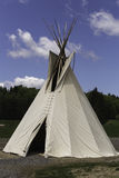 Native American teepee with a blue sky. And big white clouds Stock Images