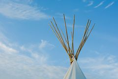 Native American Tepees on the Prairies at Sunset. An array of indigenous tee-pees on the prairie grass set up for a cultural event at sunset stock images