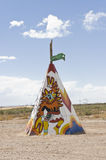 Native american tipi or teepee. Colored tipi or teepee of native american with designs in the fields of Arizona, USA, specimen of the contrasting American royalty free stock photo