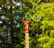Native American Totem. Ketchikan, AK, USA - May 24, 2016: Native American Totems and Clan Houses located at Totem Bight State Historic Site royalty free stock photos