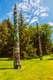 Native American Totem. Ketchikan, AK, USA - May 24, 2016: Native American Totems and Clan Houses located at Totem Bight State Historic Site stock photography