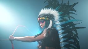 Native American woman with bow and arrows stock footage