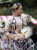 Native American woman dances in costume Royalty Free Stock Photography
