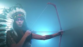 Native American woman nocking and nunting stock footage
