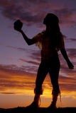 Native american woman silhouette hold out pot Royalty Free Stock Image