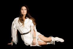 Native American woman in white outfit sit on black look straight Stock Image