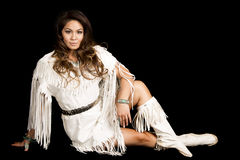 Native american woman in white outfit sit on black smile Stock Images