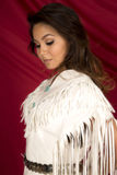 Native American woman in white on red close head look down. A Native American woman looking down with her Native dress on Royalty Free Stock Photography