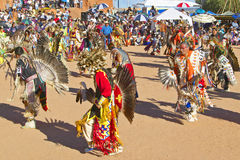 Native Americans in full regalia dancing Royalty Free Stock Photo