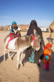 Native arabic family with donkey and goat Royalty Free Stock Image