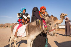 Native arabic family with donkey and goat Stock Photography