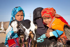 Native arabic family with donkey and goat Royalty Free Stock Photo
