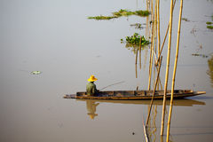 Native Asian fisherman sitting on the boat Stock Images