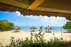 Native Beach Umbrellas on a Beach in Panglao, Philippines Royalty Free Stock Images
