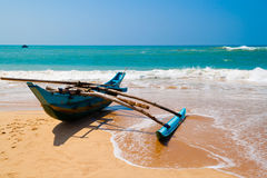 Native boat on the ocean coast. Royalty Free Stock Images
