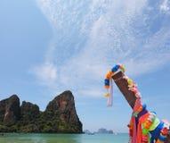 Native boat  on a sandy beach in Thailand Stock Photos