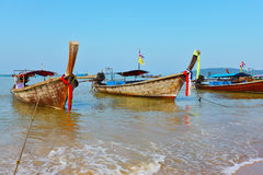 A native boats Longtail stand on an anchor Royalty Free Stock Photos