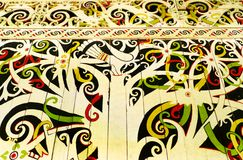 Native Borneo art, wall hornbill mural. A photograph showing a beautiful piece of traditional painting art, on the wooden wall of a ethnic tribal house.  This is Stock Image