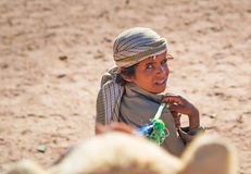 Native boy with camel in Egypt Royalty Free Stock Images