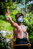 Native. Boy posing after performing traditional dances and songs to greet cruise line passagers as they arive from the cruise ship.  Lifou - the loyality island Royalty Free Stock Photos