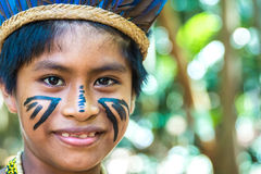 Native Brazilian boy at an indigenous tribe in the Amazon Royalty Free Stock Images